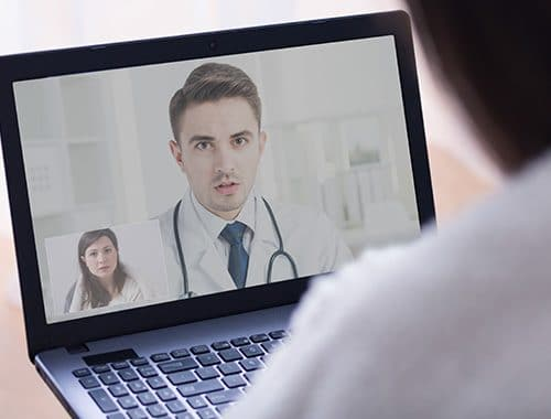 A woman sharing her medical stituation during online appointment with a doctor