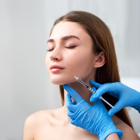 A woman is getting 'Skin treatment'