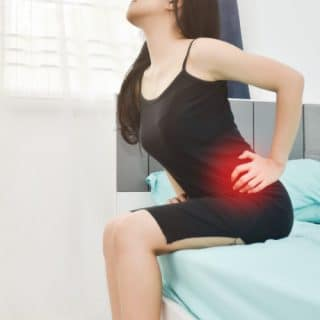 a lady suffering from severe lower back pain