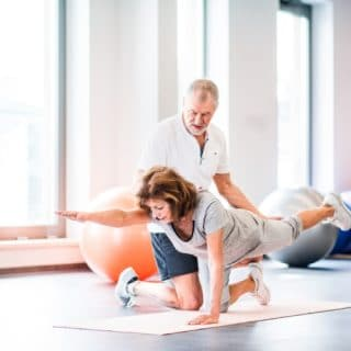 A person performing exercise for hip strengthening