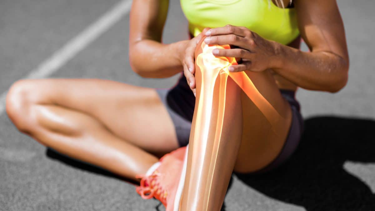 A person suffering from lower leg pain while running