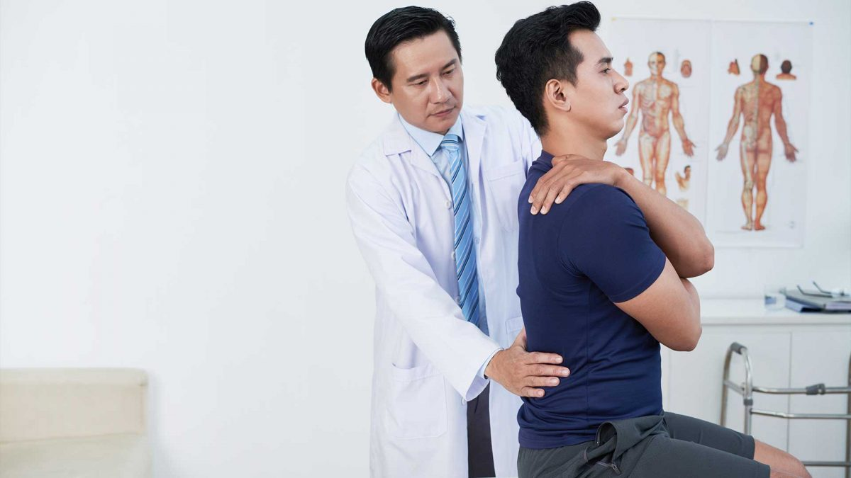 Pain management specialist checking a patient atCMW